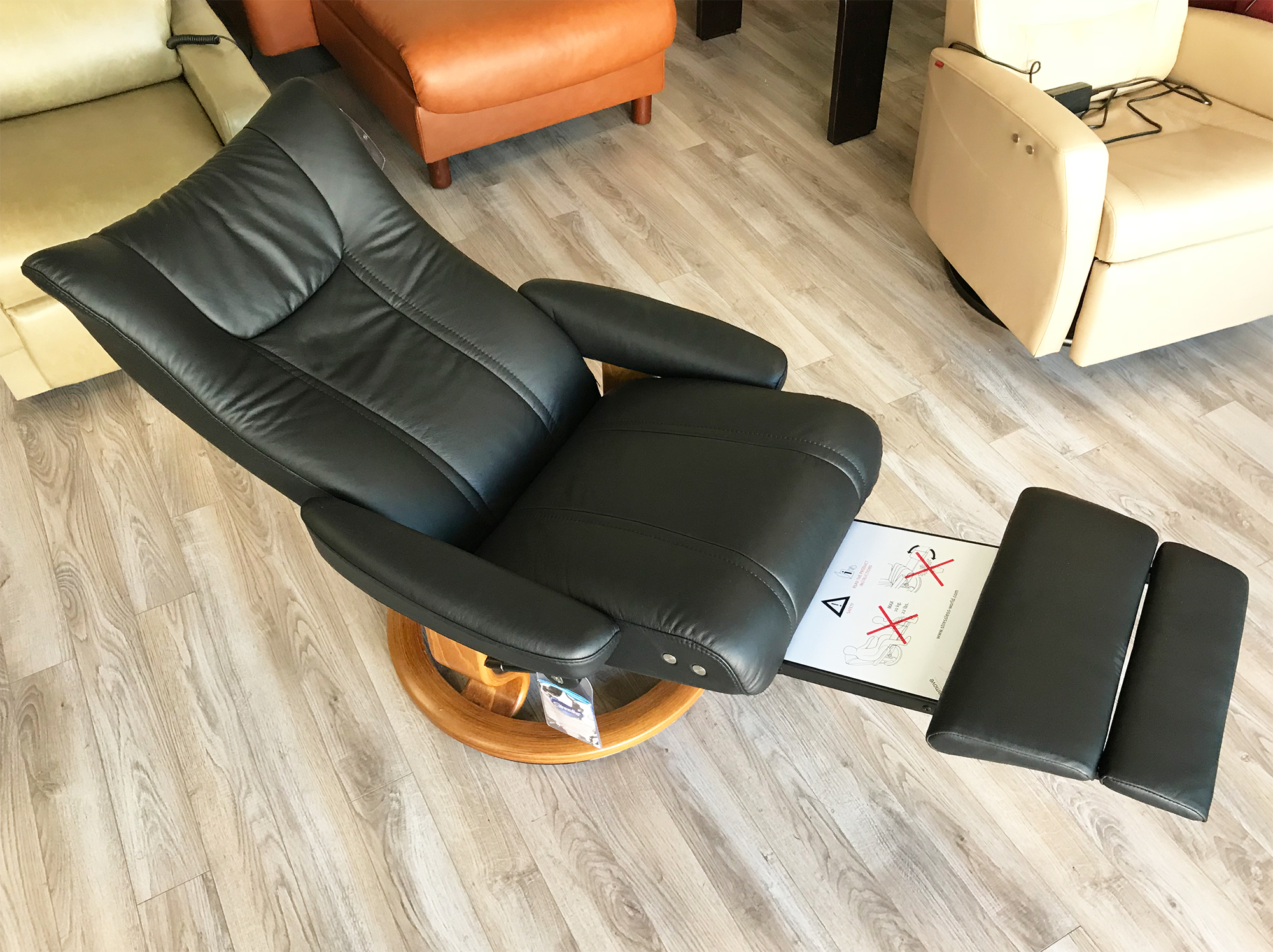 Picture of: Stressless Wing Leg Comfort Paloma Black Leather Recliner Chair With Footrest By Ekornes Stressless Wing Leg Comfort Paloma Black Leather Chairs Recliners