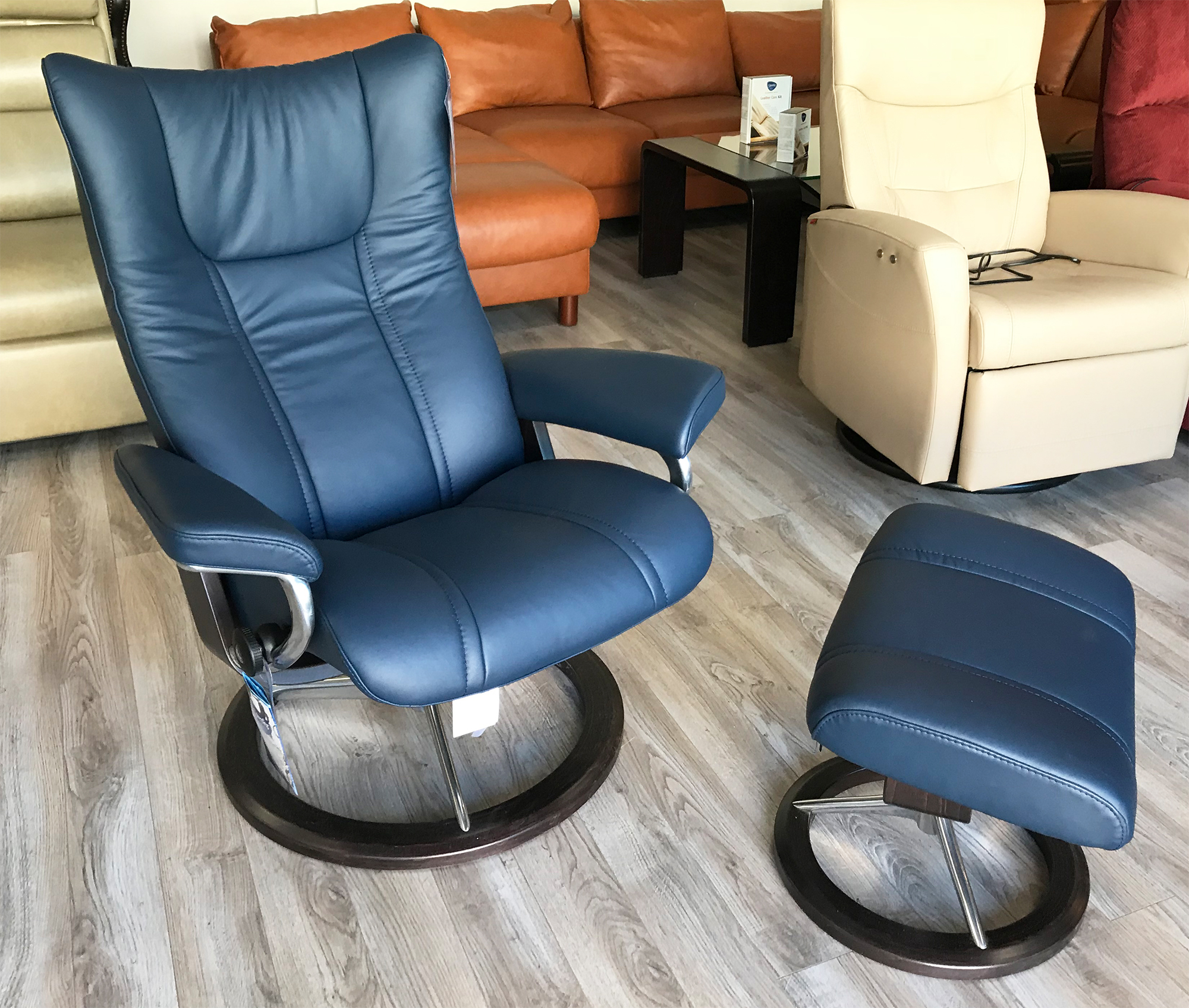 Picture of: Stressless Wing Signature Base Paloma Oxford Blue Leather Recliner Chair And Ottoman By Ekornes Stressless Wing Signature Base Paloma Oxford Blue Leather Chairs Recliners